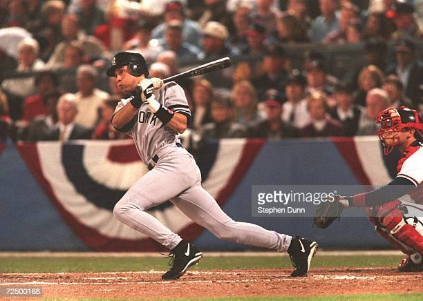 Batter Derek Jeter of New York Yankees makes contact with a pitch during the Yankees 10 win over the Atlanta Braves in Game 5 of the World Series at...