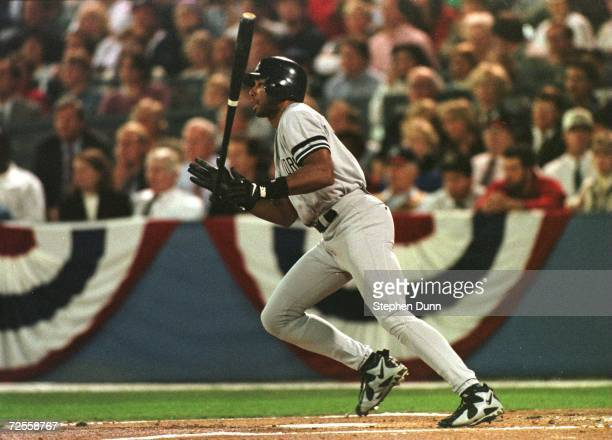 Bernie Williams of the New York Yankees gets a hit during the Yankees versus the Atlanta Braves game three of the World Series at Fulton County...
