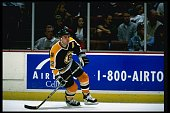 Center Adam Oates of the Boston Bruins moves down the ice during a game against the Anaheim Mighty Ducks at Arrowhead Pond in Anaheim California The...