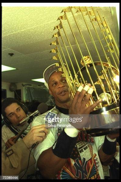 Darryl Strawberry of the New York Yankees celebrates with the World Series trophy after Game Six of the World Series against the Atlanta Braves at...