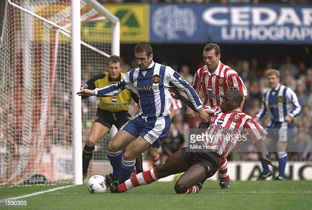 Eric Cantona of Manchester United scrambles for the ball with Ulrich Van Gobbel of Southampton during the FA Carling Premier league match between...