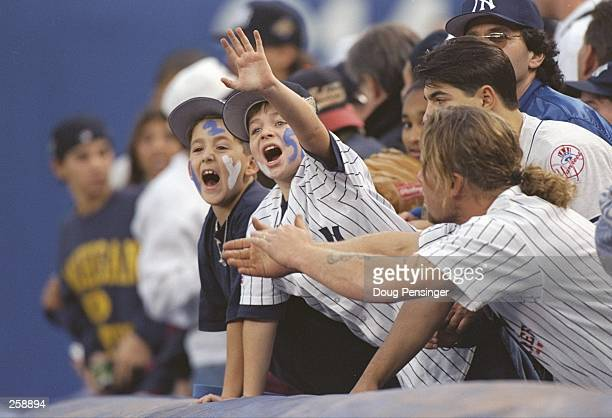 Fans of the New York Yankees wave during game six of the World Series against the Atlanta Braves at Yankee Stadium in Bronx New York The Yankees won...