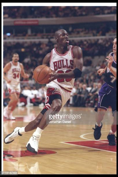 Guard Michael Jordan of the Chicago Bulls moves the ball during a game against the Sacramento Kings at the United Center in Chicago Illinois The...