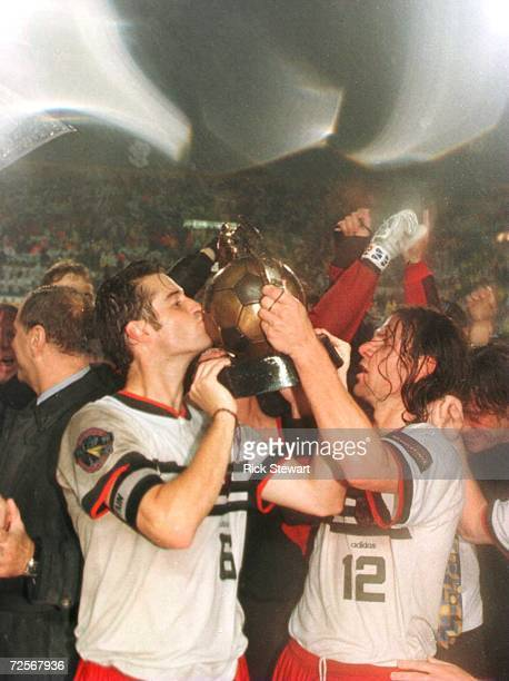 John Harkes and Jeff Agoos of DC United hoist the Alan I Rothenberg Cup after their team defeated the Los Angeles Galaxy in the Major League Soccer...