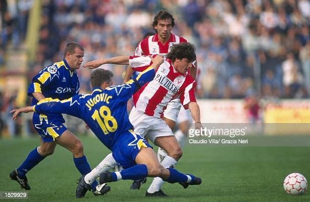 Jucovic of Juventus slides into tackle a player from Vicenza during the Serie A match between Vicenza and Juventus at Vicenza in Italy Vicenza won...
