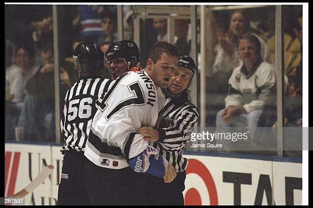 Leftwinger Matt Johnson of the Los Angeles Kings gets restrained by an official during a game against the Philadelphia Flyers at the Great Western...
