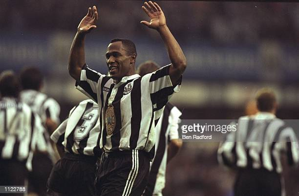 Les Ferdinand of Newcastle United raises his arms aloft during an FA Carling Premiership match against Manchester United at St James'' Park in...