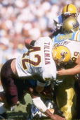 Linebacker Pat Tillman of the Arizona State Sun Devils tackles running back Skip Hicks of the UCLA Bruins during a game at the Rose Bowl in Pasadena...