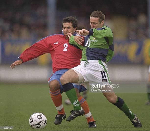 Michael Hughes of Northern Ireland is challenged by a player from Armenia during the world cup qualifier between Northern Ireland and Armenia at...