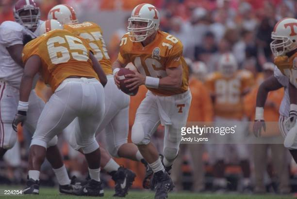Quarterback Peyton Manning of the Tennessee Volunteers rolls out of the pocket during the Volunteers 2013 victory over the Alabama Crimson Tide at...