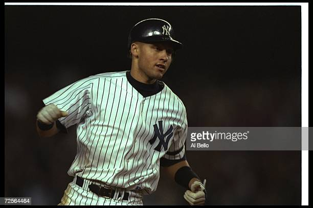 Shortstop Derek Jeter of the New York Yankees runs the bases during a championship game against the Baltimore Orioles at Yankee Stadium in New York...