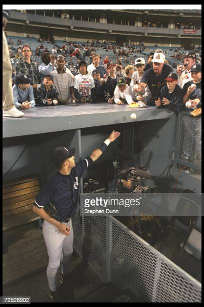 Shortstop Derek Jeter of the New York Yankees waves to fans during Game Five of the World Series against the Atlanta Braves at Fulton County Stadium...