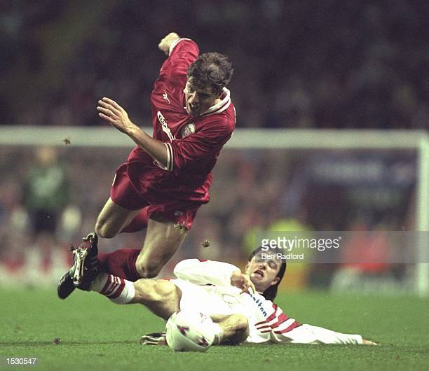 Stig Bjornebye is tripped by Frederic Chassot of Sion during the European Cup Winners Cup second leg tie between Liverpool and FC Sion at Anfield in...