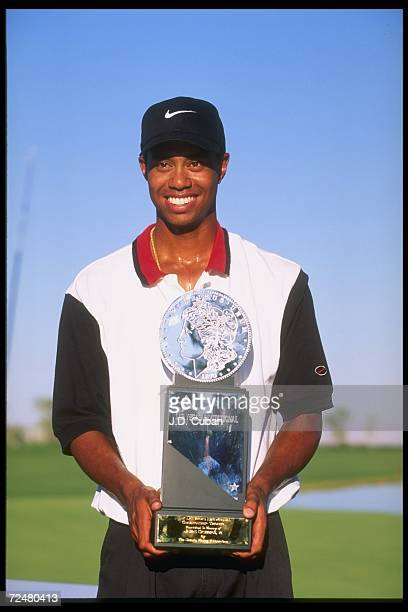 Tiger Woods holds his trophy after winning the Las Vegas Invitational in Las Vegas Nevada the first win of his pro career Mandatory Credit JD...