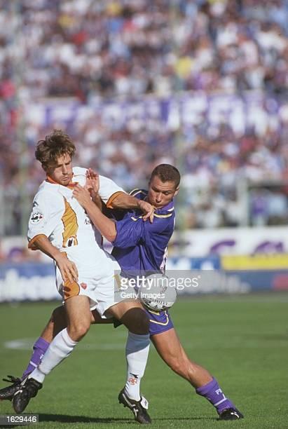 Eusebio Di Francesco of Roma challenges Anselmo Robbiati of Fiorentina during the Italian Serie A match at the Artemio Franchi Stadium in Florence...