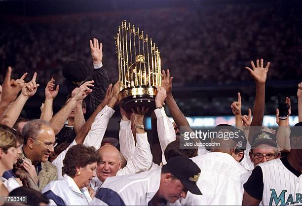 General view of players for the Florida Marlins holding the trophy after the seventh game of the World Series against the Cleveland Indians at Pro...