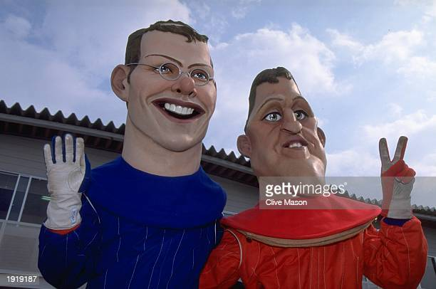 Giant dummies of Michael Schumacher of Germany and Jacques Villeneuve of Canada on qualifying day of the Japanese Grand Prix at the Suzuka Circuit in...