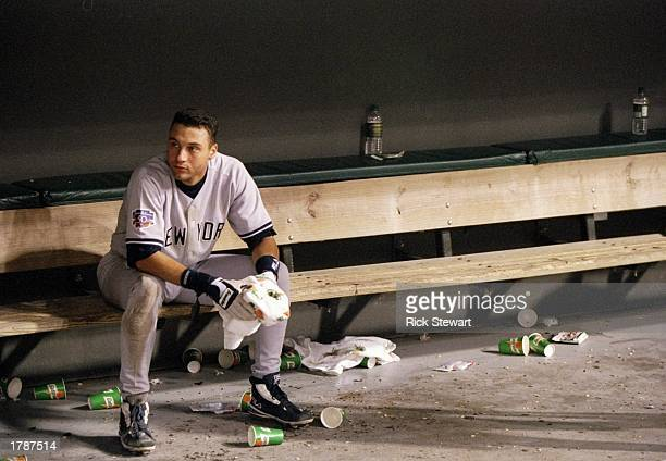 Infielder Derek Jeter of the New York Yankees looks on from the dugout after a game against the Cleveland Indians at Jacobs Field in Cleveland Ohio...