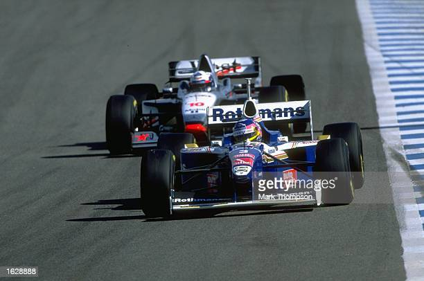 Jacques Villeneuve of Canada in his WilliamsRenault leads from David Coulthard of Great Britain in his McLarenMercedes during practise for the...