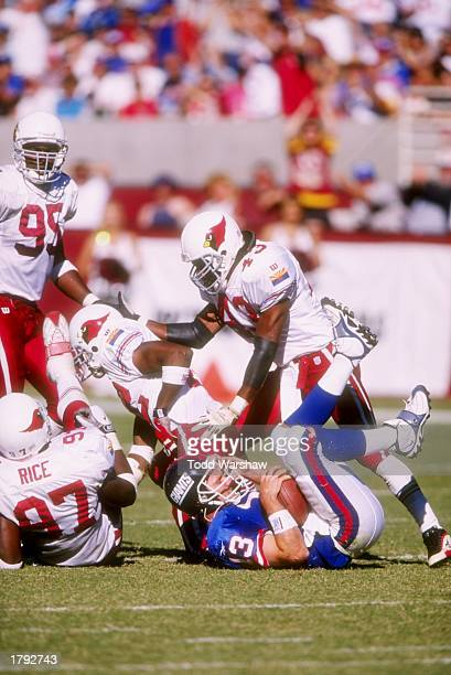 Quarterback Danny Kannell of the New York Giants is brought down by safety Matt Darby and defensive end Simeon Rice of the Arizona Cardinals during a...