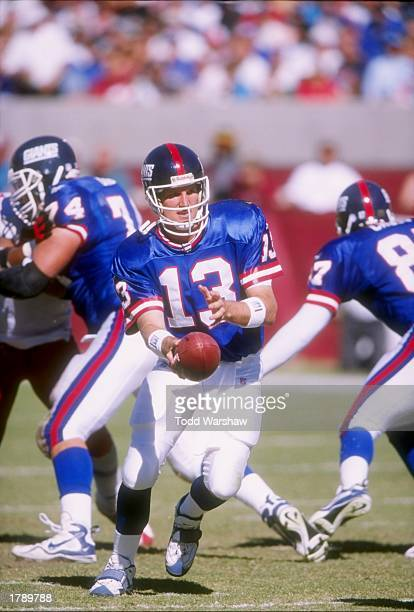 Quarterback Danny Kannell of the New York Giants scrambles with the ball during a game against the Arizona Cardinals at Sun Devil Stadium in Tempe...