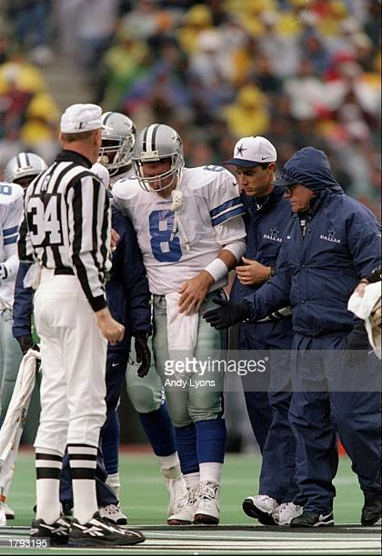 Quarterback Troy Aikman of the Dallas Cowboys gets tended to after suffering a concussion during a game against the Philadelphia Eagles at Veterans...