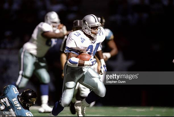 Running back Herschel Walker of the Dallas Cowboys runs with the ball during a game against the Jacksonville Jaguars at Texas Stadium in Irving Texas...