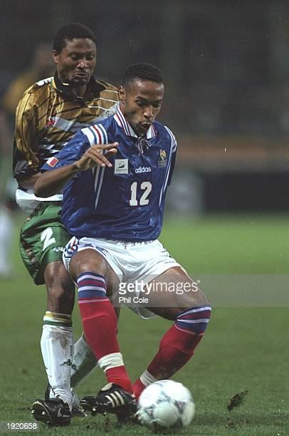 Thierry Henry of France shields the ball from Sizwe Motaung of South Africa during a Friendly match in Lens France France won the match 21 Mandatory...
