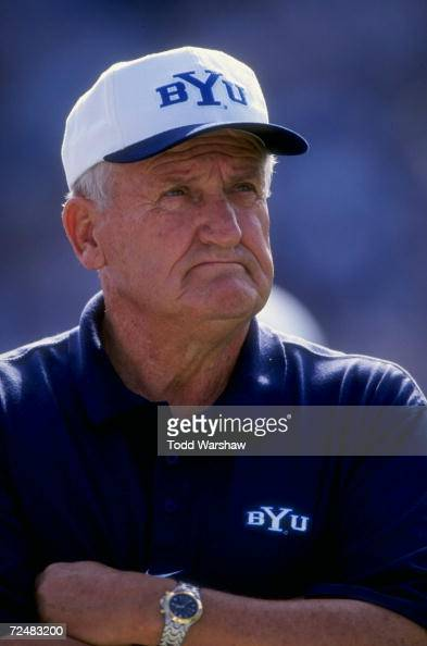 A portrait of head coach Lavell Edwards of the Bringham Young University Cougars as he watches the field during the game against the San Jose State...