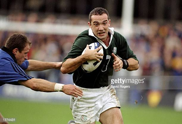 Conor O'shea of London Irish is challenged by Mike Catt of Bath during the Allied Dunbar Premiership 1 match at The Rec in Bath England Bath won the...