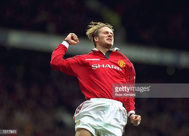 David Beckham of Manchester United celebrates after scoring a goal during the FA Carling Premiership match against Wimbledon played at Old Trafford...