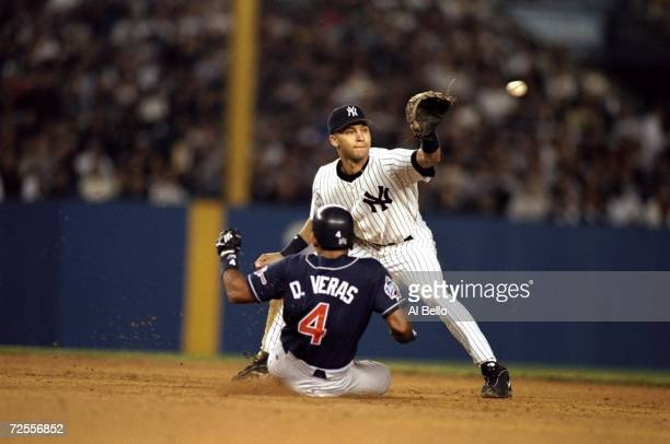 Infielder Derek Jeter of the New York Yankees in action against infielder Quilvio Veras of the San Diego Padres during the 1998 World Series Game 2...