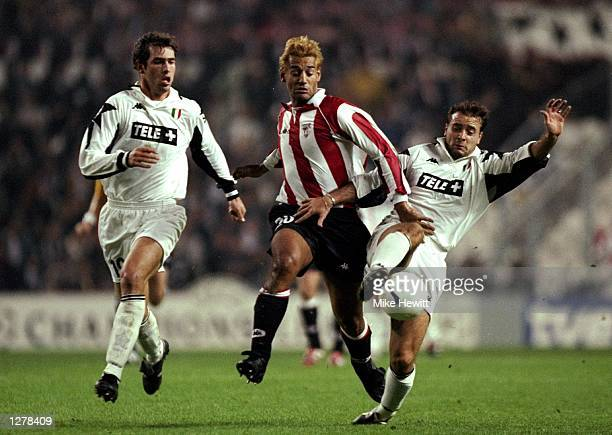 Ismael Urzaia of Athletic Bilboa takes on Alessandro Birindelli of Juventus during the UEFA Champions League match at the San Mames Stadium in Bilboa...