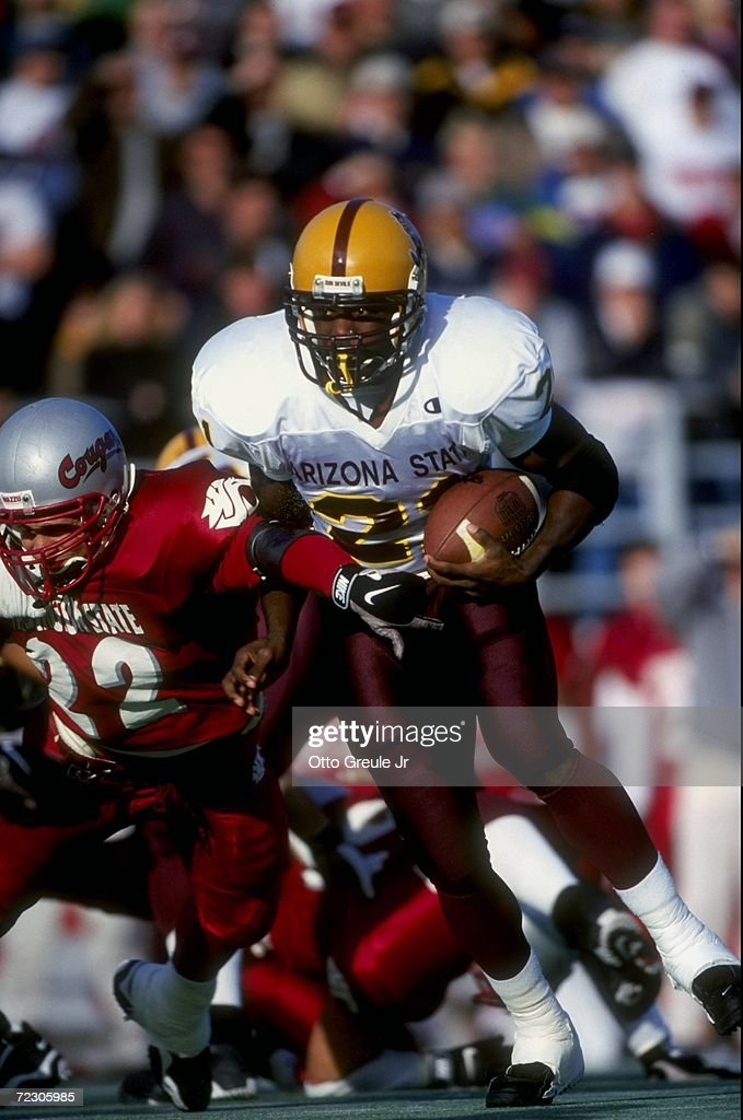Redmond #21 of the Arizona State Sun Devils grips the ball as he runs during the game against the Washington State Cougars at Martin Stadium in Pullman, Washington. Arizona State defeated Washington State 38-28. Mandatory Credit: Otto Greule Jr. /Allsport