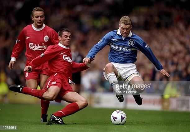 Michael Ball of Everton is challenged by Jamie Carragher of Liverpool during the FA Carling Premiership match at Goodison Park in Liverpool England...