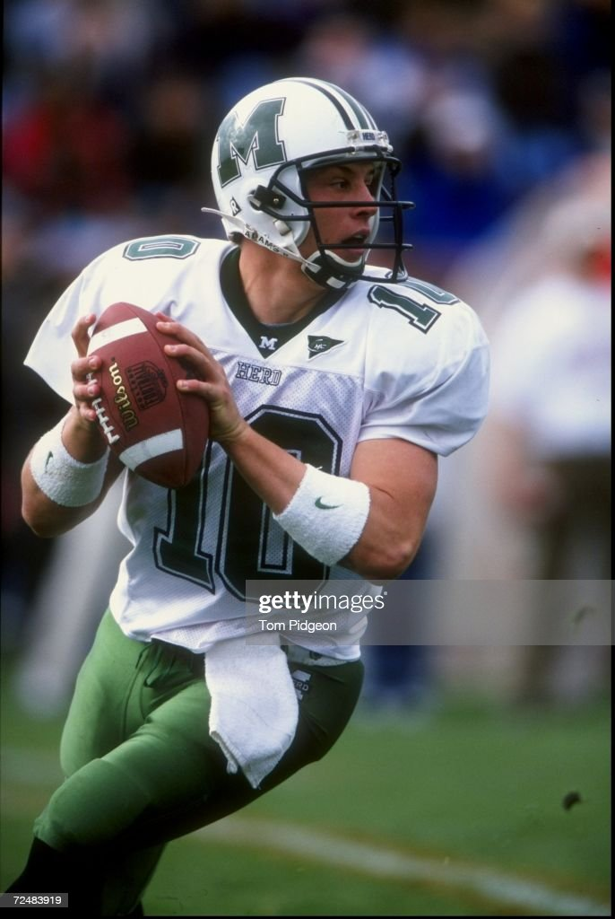 Quarterback Chad Pennington of the Marshall Thundering Herd drops back to pass during a game against the Bowling Green Falcons at Doyt L Perry Field...