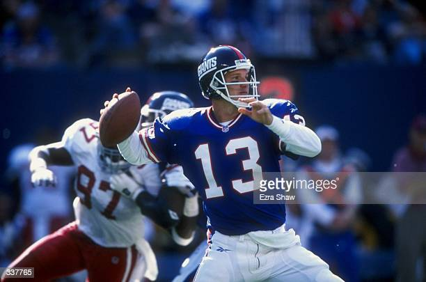 Quarterback Danny Kanell of the New York Giants prepares to throw a pass during a game against the Arizona Cardinals at the Giants Stadium in East...