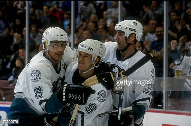 Rightwinger Teemu Selanne leftwinger Paul Kariya and center Steve Rucchin of the Anaheim Mighty Ducks in action during a game against the Boston...