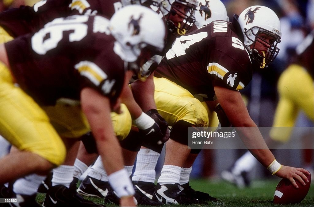 Scott Allmon of the Wyoming Cowboys prepares to snap the ball during a game against the Utah Runnin'' Utes at the War Memorial Stadium in Laramie...