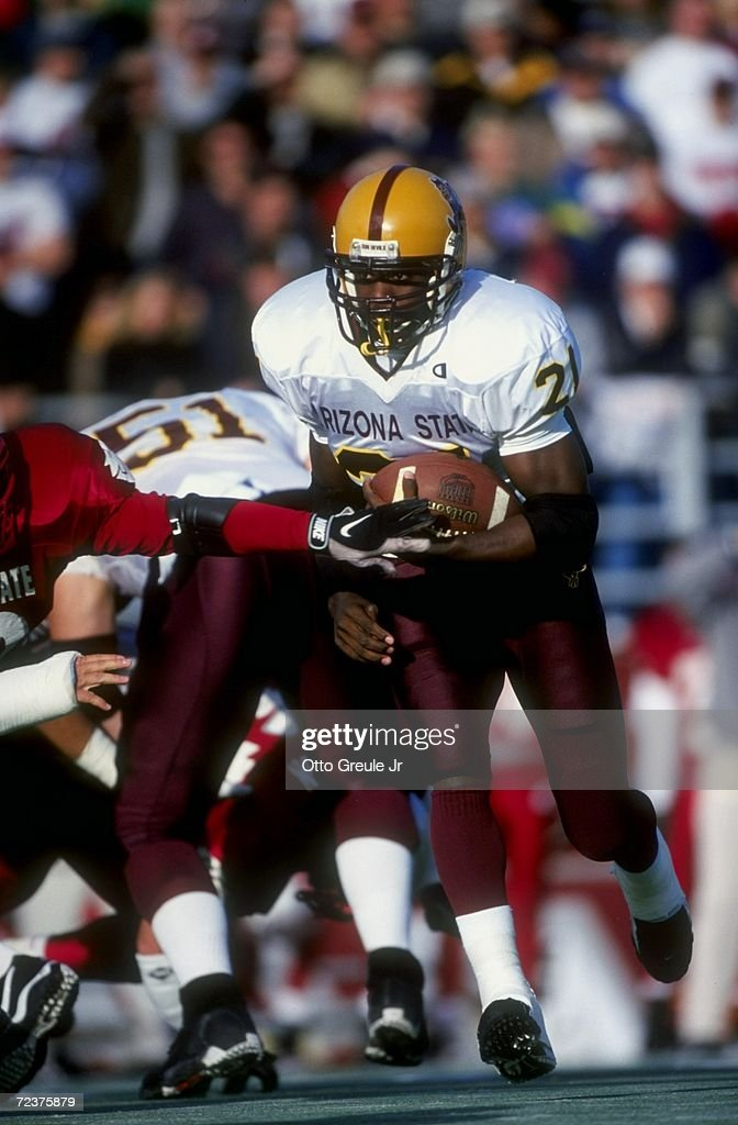 Tailback J. R. Redmond #21 of the Arizona State Sun Devils in action during the game against the Washington State Cougars at the Martin Stadium in Pullman, Washington. The Sun Devils defeated the Cougars 38-28.
