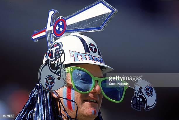 A fan of the Nashville Titans wears a Titan hard hat with big glasses in support during a game against the St Louis Rams at the Adelphia Coliseum in...