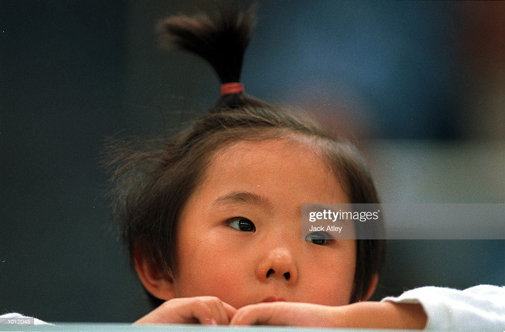 A young fan watches proceedings during the womens qualifying round at the 1999 Tianjin World Gymnastics Championships, Tianjin, China. Mandatory Credit: Jack Atley/ALLSPORT