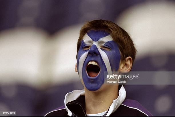 A young Scotland fan during the Rugby World Cup quarterfinal playoff match against Samoa at Murrayfield in Edinburgh Scotland Scotland won 3520...