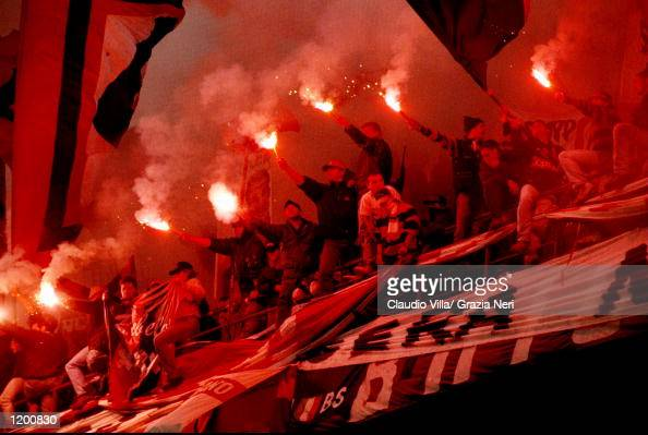 AC Milan fans light flares during the Serie A match against Inter Milan at the San Siro in Milan Italy Mandatory Credit Claudio Villa /Allsport