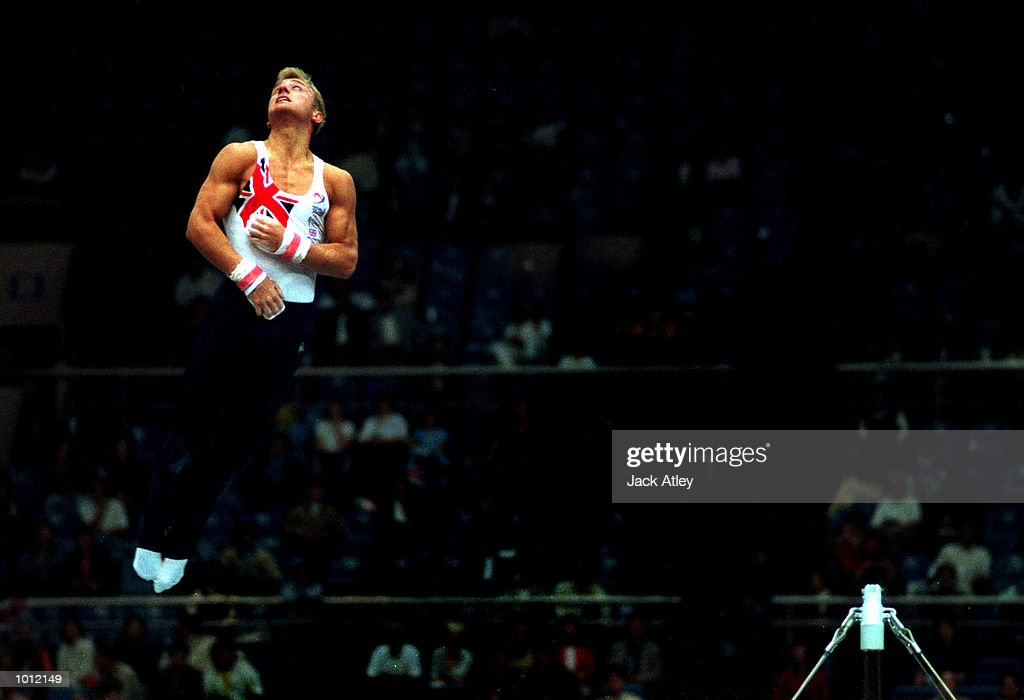 Andrew Atherton of Great Britain flies off the top during his horizontal bar routine during the mens qualifying round at the 1999 Tianjin World Gymnastics Championships, Tianjin, China. Mandatory Credit: Jack Atley/ALLSPORT