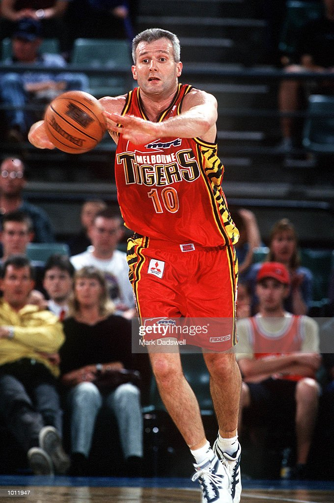 Andrew Gaze of the Melbourne Tigers passes, in the NBL match between the Melbourne Tigers and the Cairns Taipans, played at Melbourne Park, Melbourne, Australia. Mandatory Credit: Mark Dadswell/ALLSPORT