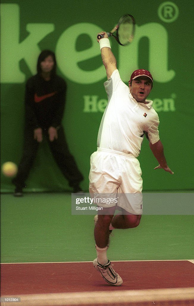 Andrew Ilie, of Australia plays a backhand during his first round match against Ramon Delgardo, of Paraguay during the Heineken Singapore Tennis Open, played at the Singapore Indoor Stadium, Singapore.Ilie won: 6-2, 6-2. Mandatory Credit: Stuart Milligan/ALLSPORT