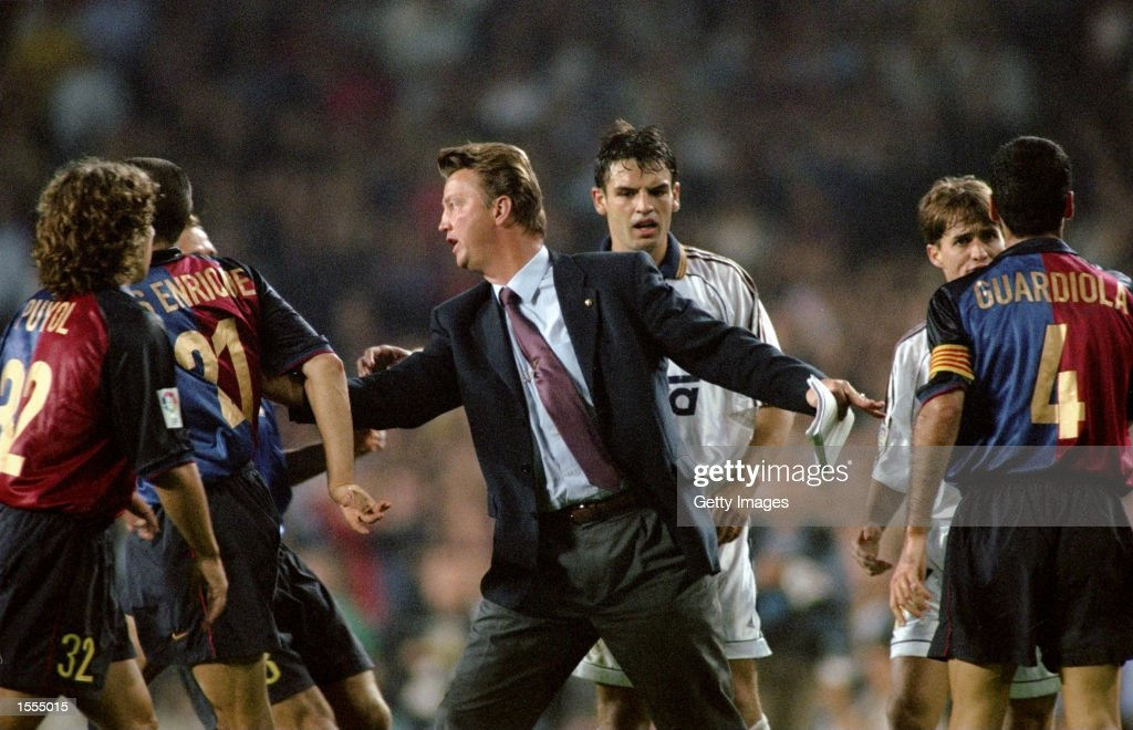 Barcelona coach Louis van Gaal calms his players down against Real Madrid during the Spanish Primera Liga match at the Nou Camp in Barcelona, Spain. The game ended 2-2. \ Pic: Nuno Correia \ Mandatory Credit: Allsport UK /Allsport