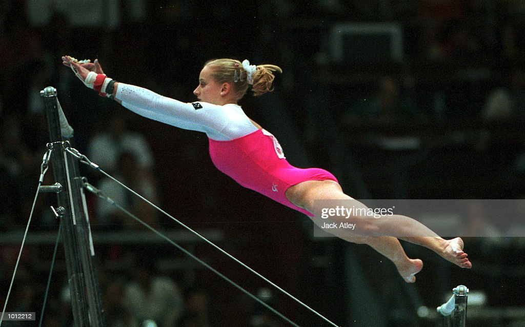 Brooke Walker of Australia flies towards the top bar during her uneven bars routine in the final of the womens teams event at the 1999 Tianjin World Gymnastics Championships, Tianjin, China. Australia finished fifth. Mandatory Credit: Jack Atley/ALLSPORT