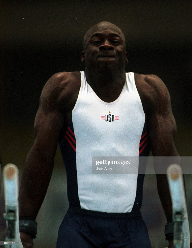 Chris Young of the United States strains during his parallel bars routine during the mens qualifying round at the 1999 Tianjin World Gymnastics Championships, Tianjin, China. The United States finished in third place overall after six of the eight subdivisions. Mandatory Credit: Jack Atley/ALLSPORT